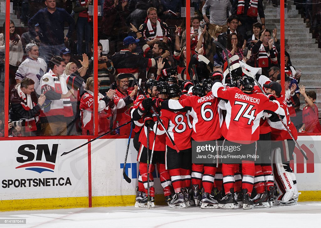 The Ottawa Senators celebrate their overtime goal against the Toronto Maple Leafs in their home opener at Canadian Tire Centre on October 12, 2016 in Ottawa, Ontario, Canada.