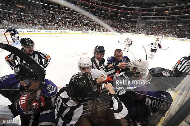 The Ottawa Senators fight with the Los Angeles Kings alongside the boards during the game on December 3, 2009 at Staples Center in Los Angeles,...