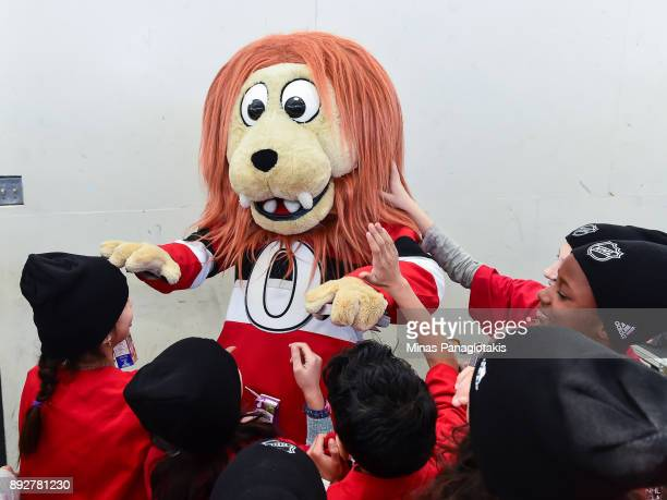 The Ottawa Senators mascot Spartacat greets the children during the 2017 Scotiabank NHL100 Classic Legacy Project press conference at the Boys Girls...