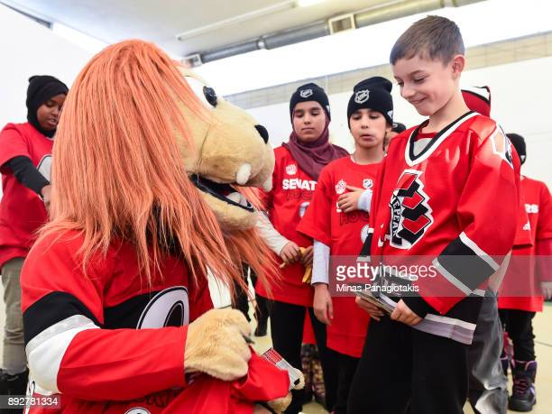 The Ottawa Senators mascot Spartacat signs autographs for the children during the 2017 Scotiabank NHL100 Classic Legacy Project press conference at...
