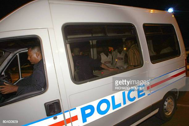 The ousted rebel leader of the Comoros island of Anjouan Mohamed Bacar and some Anjouan soldiers are transported by a police van early March 28 2008...