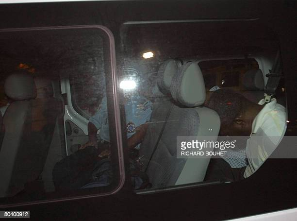 The ousted rebel leader of the Comoros island of Anjouan Mohamed Bacar is transported by a police van early March 28 2008 upon arrival in Saint Denis...