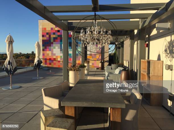 The outdoor dining area on the roof of Halcyon Hotel where you'll also find a pool and cabanas several floors above Denver street level