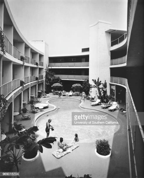 The outdoor hotel swimming pool of the Beverly Hilton Beverly Hills California early to mid twentieth century