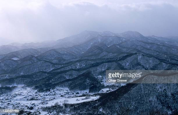 The outer suburbs of Sapporo covered in snow, viewed from the summit of Moiwa-yama