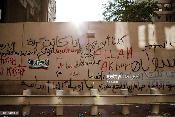 The outer wall of the United States Embassy in Egypt covered in graffiti the morning after it was vandalised by protesters during a demonstration on...