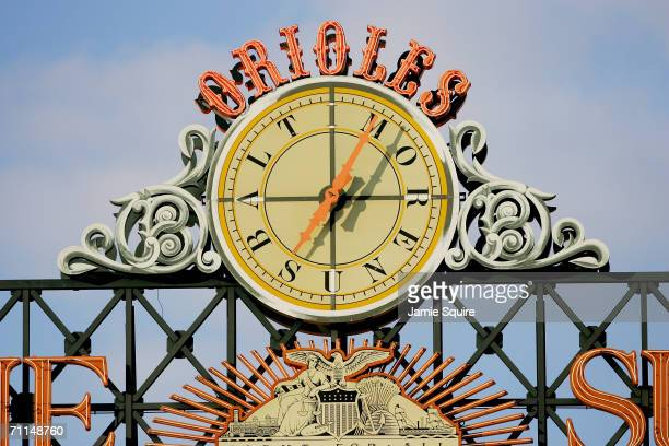 The outfield clock above the scoreboard is shown during the Baltimore Orioles game against the Toronto Blue Jays at Oriole Park at Camden Yards on...
