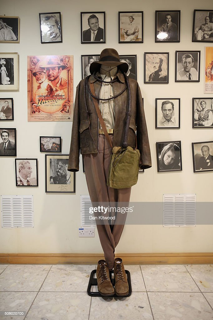 The outfit worn by Harrison Ford in the film Indiana Jones is displayed near actors' headshots and movie stills at Angels Costume House on January 20, 2016 in London, England. Angels Costumes established in 1840 is in its 175th year, and is the longest-established and largest professional costume house in the world. The costumier is to receive the 'Outstanding British Contribution to Cinema Award' at the EE British Academy Film Awards ceremony at Londons Royal Opera House on Feb 14, 2016.