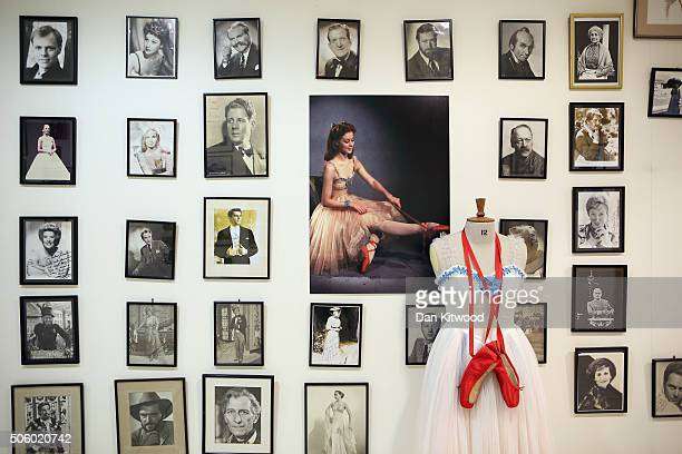 The outfit worn by Moira Shearer in the film Red Shoes is displayed near actors' headshots and movie stills at Angels Costume House on January 20...