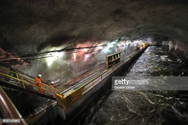 The outflow canal at HydroQuébec's Bersimis1 power plant in Baie Comeau Québec feeds into the Betsiamites River below a mountain 50 miles north of...