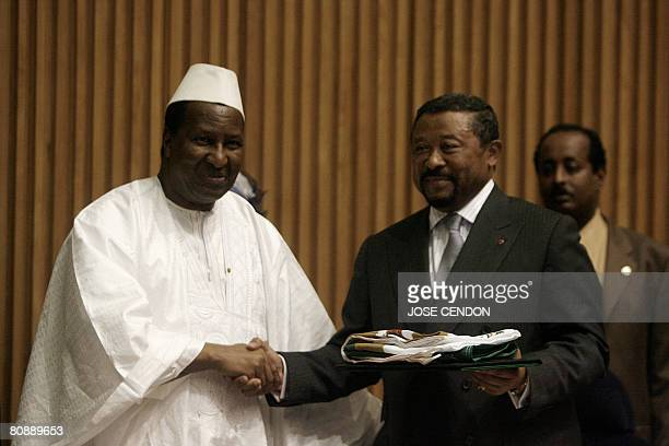 The outgoing Chairperson of the African Union Commission Alpha Omar Konare hands over the Symbols of the Union to the incoming Chairperson of the...