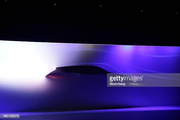 The outline of Jaguar CX17 SUV prototype automobile produced by Tata Motors Ltd's Jaguar Land Rover unit is seen through a cloth background during...