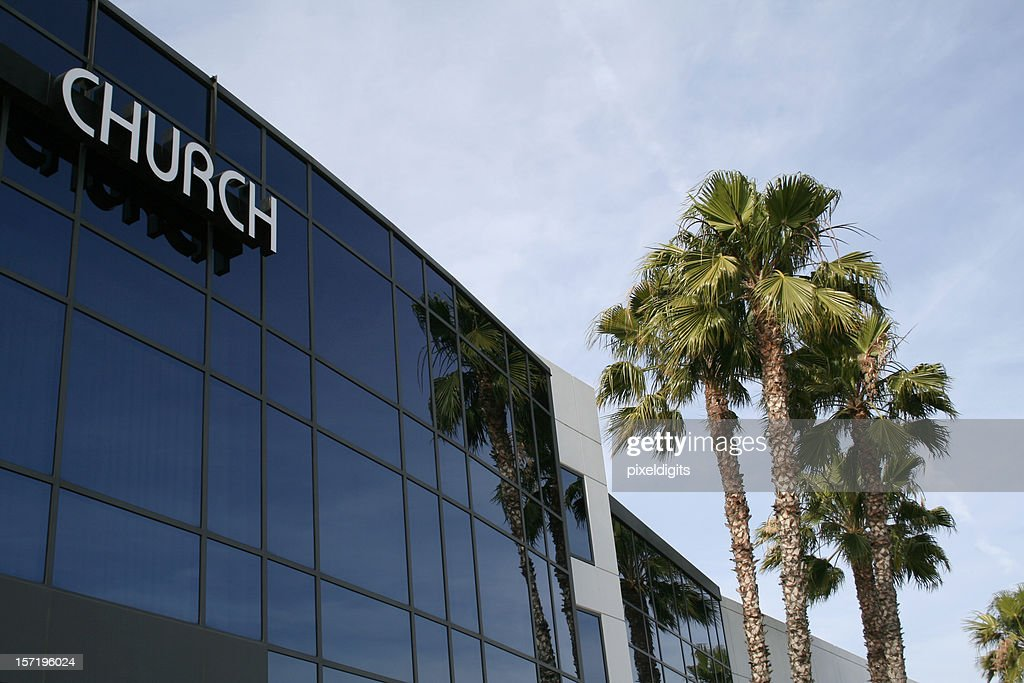 The outside of a modem church building and palm trees : Stock Photo