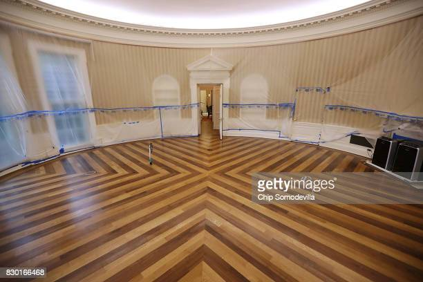 The Oval Office sits empty and the walls covered with plastic sheeting during renovation work at the White House August 11 2017 in Washington DC The...