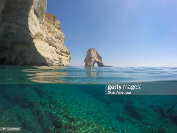 the over & under of the milos coastline - griechenland stock-fotos und bilder