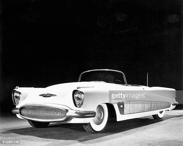 The overall futuristic design of Buick's XP300 is emphasized in this view of the new experimental car The hood and front fenders are a single welded...