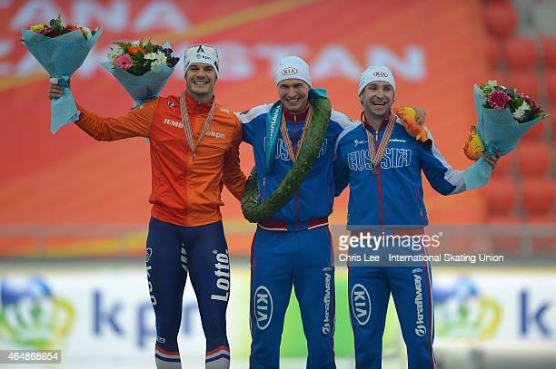 The overall top three Hein Otterspeer of Netherlands Pavel Kulizhnikov and Aleksey Yesin of Russia during Day 2 of the ISU World Sprint Speed Skating...