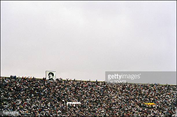 The overcrowded AlChaab stadium in Baghdad The image of dictator Saddam Hussein is ubiquitous in Baghdad Iraq in June 2002