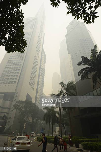 The Overseas Union Bank Centre building, left, and the United Overseas Bank Plaza Two building, right, stand shrouded in smog in Singapore, on...