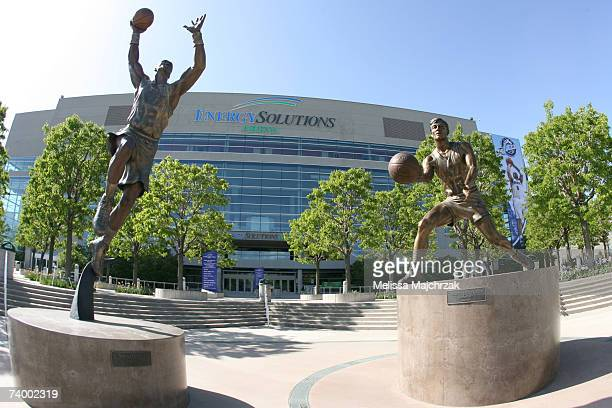The oversize banner of Carlos Boozer of the Utah Jazz greets fans along with statues of former Jazz players Karl Malone and John Stockton prior to...