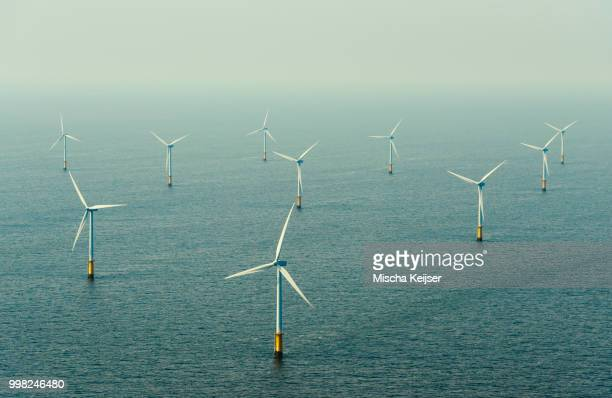 the owez windfarm, ijmuiden, noord-holland, netherlands - windmills stock photos and pictures