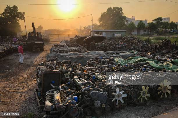 The owner checks his truck engines at a truck scrapyard on June 6 2018 in Te Lo Village Yen Lac District Vinh Phuc Province Vietnam Vietnam has...