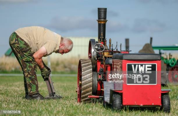 The owner of a miniature steam engine makes final preparations before displaying during the final day of the Whitby Traction Engine Rally on August...