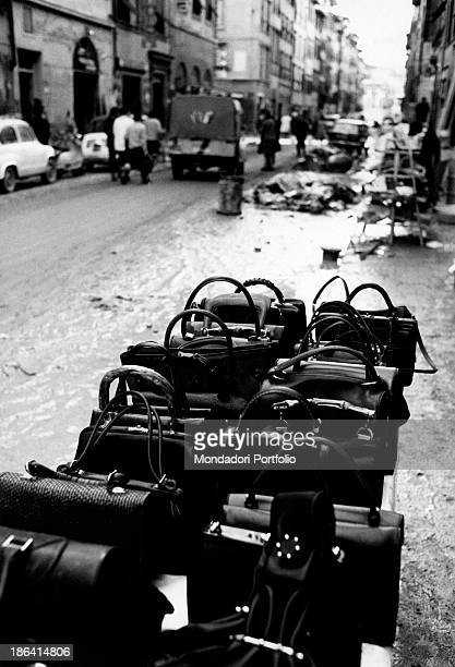 The owner of a shop aligned on a stall some handbags cleaned from the mud of the flood to sell them back at a lower price Florence November 1966