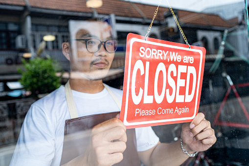 the owner of a small business shop came to closed the shop. 1185372985