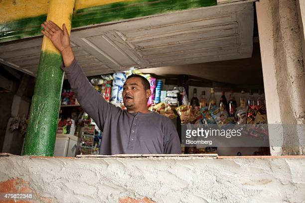 The owner of a store talks to a reporter in the Dilma Rousseff favela of Rio de Janeiro Brazil on Monday July 6 2015 As the fastest inflation in more...