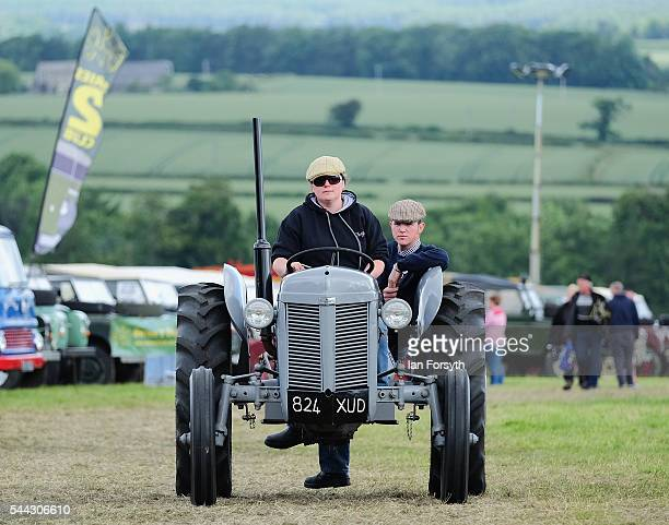 The owner of a vintage tractor drive to their position at the annual Duncombe Park Steam Fair on July 3 2016 in Helmsley England Held in the...