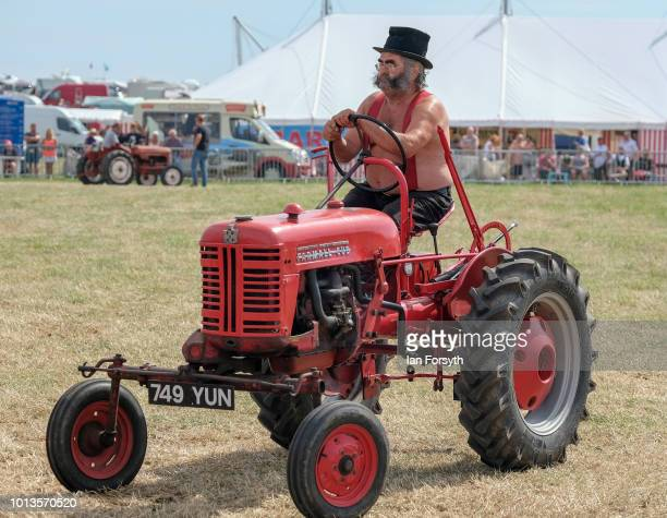 The owner of a vintage tractor drives around the main arena as he displays during the final day of the Whitby Traction Engine Rally on August 5, 2018...