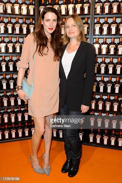 The owner of Blush Claudia Kleinert and actress Julia Malik attend the runway at Cointreau Fizz Secret Garden presenting 'Blush' during MercedesBenz...