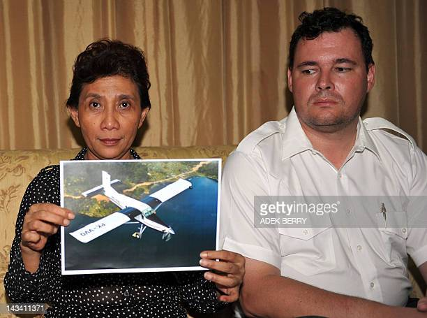 The owner of Susi Air, Susi Pudji Astuti , holds a picture of the Pilatus PC-6 aircraft that crashed in East Kalimantan next to Susi Air director of...