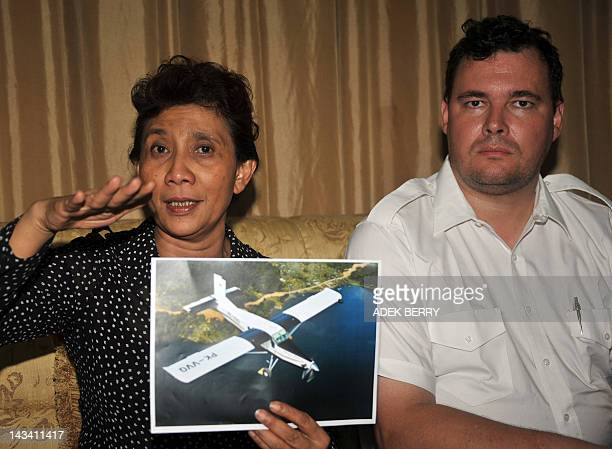 The owner of Susi Air, Susi Pudji Astuti , holds picture of the Pilatus Porter PK-VVQ next to Susi Air director of operations Christian Von Strombeck...