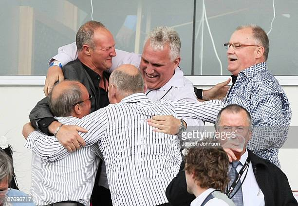 The owners of Sundown In Paris that won the Cromwell Lake Dunstan Handicap Trot race celebrate during New Zealand Trotting Cup Day at Addington...