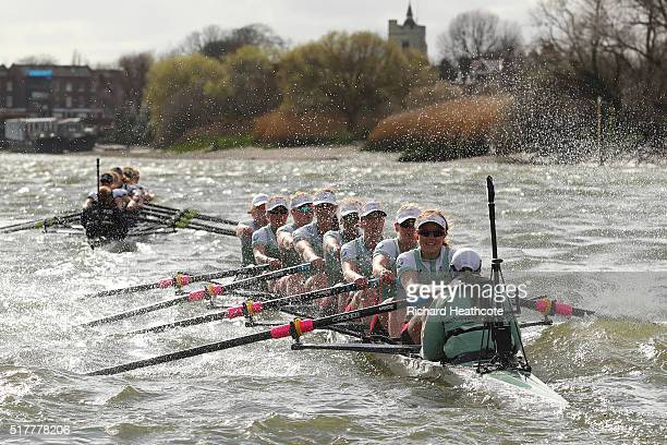 The Oxford boat leads the Cambridge boat during The Cancer Research UK Women's Boat Race on March 27 2016 in London England