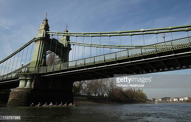 The Oxford crew pass under Hammersmith Bridge during a training session for the Xchanging 2011 Boat Race on The River Thames on March 24 2011 in...
