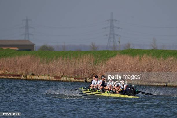 The Oxford crew warm up ahead of the 166th annual men's boat race between Oxford University and Cambridge University on the River Great Ouse in Ely,...