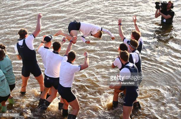 The Oxford men's crew celebrate winning the Cancer Research UK Boat Race by throwing Samuel Collier cox of The Oxford men's crew into the river on...