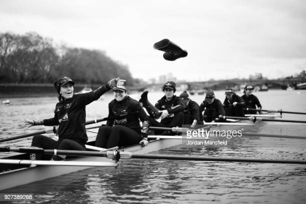 The Oxford Osiris crew throw their wellies as they prepare their boat prior to heading out on the water during the Boat Race Trial fixture between...