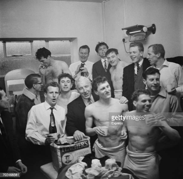 The Oxford United FC team celebrate after a 5th round win against Blackburn Rovers in the FA Cup 15th February 1964