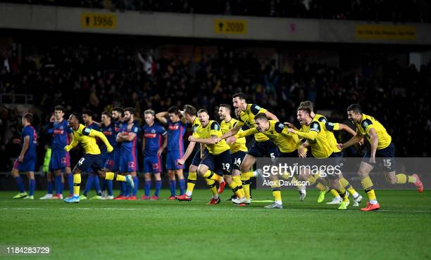 The Oxford United Team celebrate victory in the penalty shoot out as the Sunderland AFC team react during the Carabao Cup Round of 16 match between...