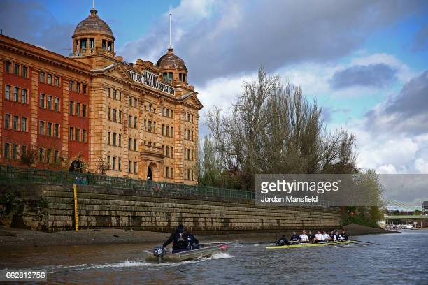 The Oxford University Boat Club pass the Harrods Furniture Depository during the Cancer Research Boat Races Tideway Week on April 1 2017 in London...