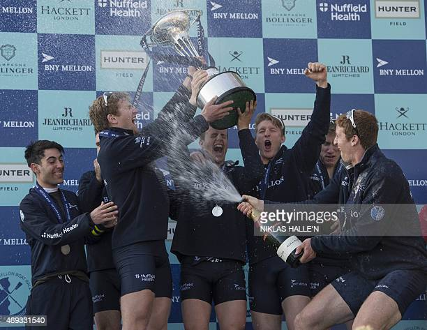 The Oxford University boat crew celebrate after beating Cambridge in the boat race between Oxford university and Cambridge university on April 11...