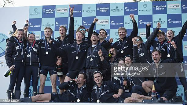 The Oxford University men and women boat crews celebrate after both teams beat Cambridge in the boat race between Oxford university and Cambridge...