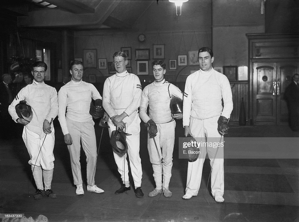 The Oxford V Cambridge Fencing Championships at the London Fencing Club in St James, London, 19th February 1926. Pictured are the Oxford team, (left to right) G. Toynes, Crown Prince Olav of Norway (1903 - 1991, later King Olav V of Norway), J. W. Ogilvie, team captain Cyril Simey (1905 - 1952) and M. H. P. Bull.