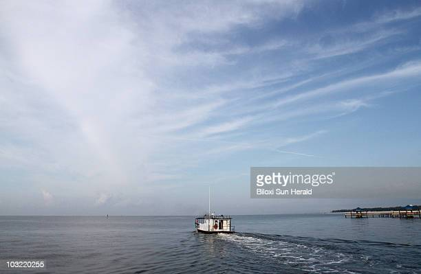 The oyster boat Denise Rene leaves the Pass Christian Harbor in Biloxi Mississippi on Wednesday May 19 2010The boat is working for Parsons Corp in...