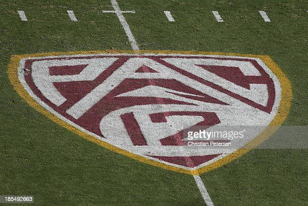 The 'Pac 12' logo is displayed on the filed during the college football game between the Washington Huskies and the Arizona State Sun Devils at Sun...