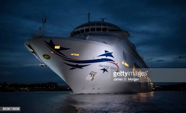 The Pacific Dawn cruise ship slips under the Gateway Bridge and into her berth on March 16 2017 in Brisbane Australia The PO Cruises ship is...